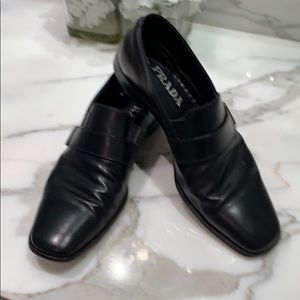 Prada black sleek slip on leather shoes